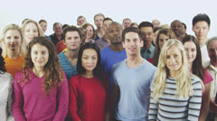 Happy, diverse group in casual clothing looking upwards to copyspace Stock Footage