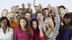 Happy, diverse group in casual clothing raise their hands Stock Footage