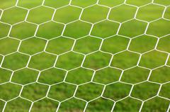 Close up on white football net, green grass Stock Photos