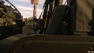 JEEP WITH MILITARY ARMOR AND GUNS LOADED FOR WAR BATTLE HD 1080 HIGH DEFINITION Stock Footage