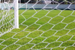 net soccer goal football green grass field - stock photo