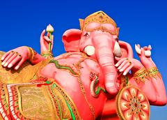 Pink giant ganesha statue in relax position - stock photo