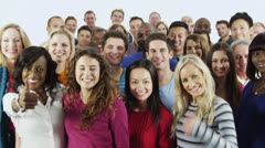 Happy, diverse group in casual clothing give a thumbs up Stock Footage