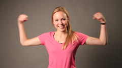 A pretty White Caucasian Woman lifts her hands up Stock Footage