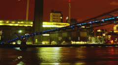 View of Millennium Bridge and Tate from Thames river - stock footage