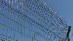 Metal fence with concertina against sky 2 Stock Footage
