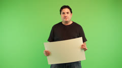 A fat Brunette Young Man holding the cardboard in his hand Stock Footage
