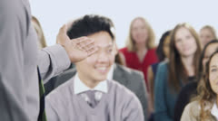 Diverse group of business people attend a business seminar - stock footage