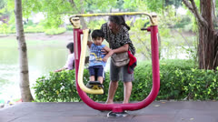 Asian Mother And Son Exercising At The Park Together Stock Footage