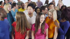 Happy multi-ethnic group of friends in colorful casual clothing Stock Footage