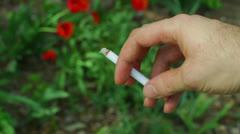 Nervously holding cigarrette hold shakey Stock Footage