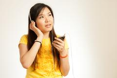 Asian woman enjoy music Stock Photos