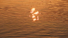 Sun reflection in water surface, tranquil scene - stock footage