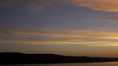 Chile, Chiloe, Stratified Sunset Sky Pan Stock Footage