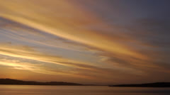 Chile, Chiloe, Golden Stratified Cloud Sunset w Distant Sea Bird Stock Footage