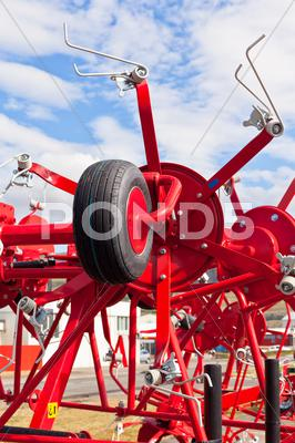 Stock photo of new hay raker farm equipment detail