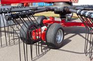 New hay raker farm equipment detail Stock Photos
