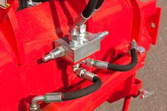 Hydraulic system hoses on machine Stock Photos