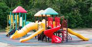 Colourful playground equipment Stock Photos