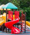 Colourful playground equipment Stock Photos