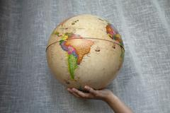 Stock Photo of world globe in a woman hand detail