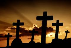 cross silhouette and the clouds at sunset - stock photo