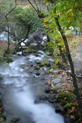 Long exposure in a river at autumn time Stock Photos