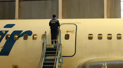 Service Utair aircraft in the hangar. Repair. Airport Stock Footage