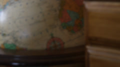 Old world globe, close-up. Smoothly pan left, tilt up, focus in. HD 1080p 24fps. Stock Footage