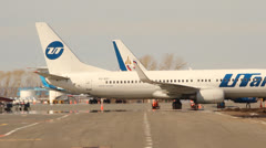 Boeing-737 UTair, board room VQ-BQP at the terminal Stock Footage