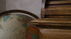 Old globe close-up. Smoothly pan left, tilt down, rack-focus in. HD 1080p 24fps. Stock Footage
