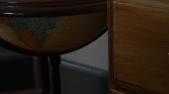 Close-up. Slowly tilt up along old globe showing Atlantic Ocean. HD 1080p 24fps. Stock Footage
