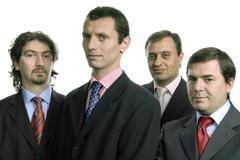 Neljä nuorta liikemiehiä eristetty valkoinen Kuvituskuvat