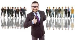 Stock Photo of business man in front of a group of people