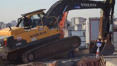 Raising hydraulic excavator to perform maintenance Stock Footage