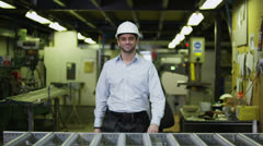 Portrait of a happy and attractive male warehouse worker - stock footage