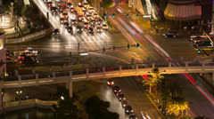Busy city intersection car traffic timelapse at night Stock Footage