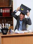 Stock Photo of aggression man in office