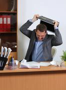 Aggression man in office Stock Photos