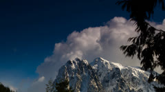 Time lapse: Clouds over mountain 2 Stock Footage