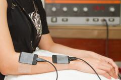 electrical stimulation forearm ,eletrical stimulator for increase muscle stre - stock photo