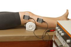 Therapist treatment patient  with eletrical stimulator for increase muscle st Stock Photos