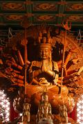 Guan yin sculpture thousand hand carved of wood Stock Photos