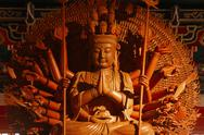 Stock Photo of guan yin sculpture thousand hand carved of wood