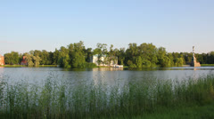 Buildings and monuments on lake, Pushkin park St. Petersburg - timelapse in Stock Footage