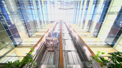 Elevator rides with passengers at building with transparent roof Stock Footage