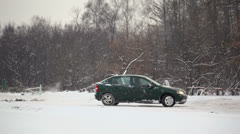 Man rides around in car by country road with snow at winter day Stock Footage