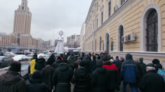 People walk by avenue of A.Saharov with huge effigy of woman Stock Footage