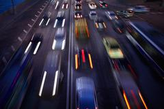 Car traffic at night. Motion blurred background. Stock Photos