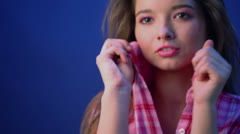 Pretty girl in pink plaid shirt holds collar when poses Stock Footage